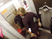Exhibitionist girl secretly masturbating in dressing room at store