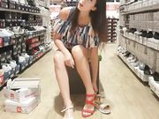 Young girl with no panties filmed with candid camera in shoe store
