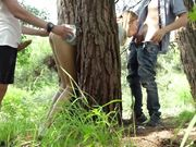 Two strangers fuck in pussy and mouth a horny girl in the forest