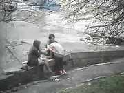 Girl watching an exhibitionist couple making sex in park